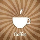 Die Kaffeetasse auf einem braunen Hintergrund. Stockfotos