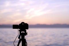 Die Kamera bei Sonnenuntergang Stockbild