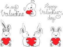 Die Kaninchen und der Bär des Valentinsgrußes mit rotem Herzen Stockfoto