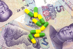 Die Kapseln auf dem Yuan Lizenzfreies Stockfoto