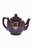 Die keramische Teekanne der Weinlese lokalisiert auf weißem Hintergrund Stockbild