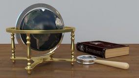 Die Kugel auf dem Tisch mit einem Buch und einer Lupe Lizenzfreies Stockbild