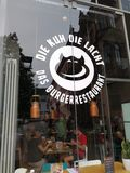Die Kuh die lacht burger restaurant. Mannheim, Germany - August 24, 2017: Die Kuh die lacht - Das Burgerrestaurant restaurant exterior. Burger restaurant in royalty free stock photos
