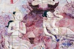 Die Kunst auf einer Wand im Tempel von Thailand stockbild
