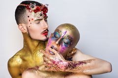 Die Kunst mit zwei Leuten bilden Stockfotos