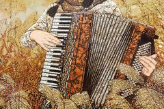 Die Lackmalerei des weiblichen Akkordeonspielers in den Schilfen, luftgetrockneter Ziegelstein rgb Lizenzfreie Stockbilder