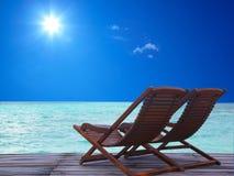 Die Lehnsessel auf dem Strand Lizenzfreies Stockfoto