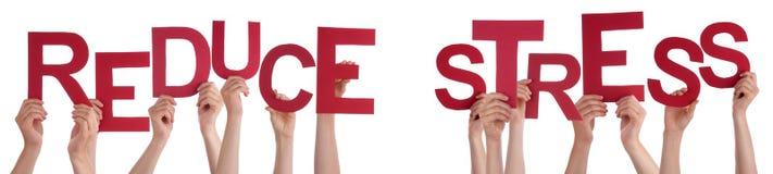 Die Leute-Hände, die rotes Wort halten, verringern Druck Stockbild