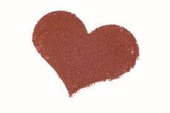 Die Liebe, die in Kakao geschrieben wurde, zerstreute Stockfotos