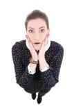 Die lustige junge schöne Geschäftsfrau im schwarzen Kleid überrascht ist Stockbilder