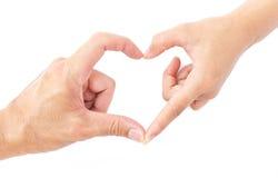 Die männlichen und weiblichen Hände, die Herz machen, formen Symbol für Liebhaber concep stockfotos