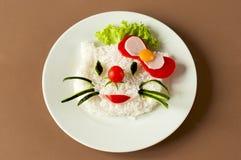 Die Mahlzeit der Kinder mit Reis Lizenzfreie Stockfotos