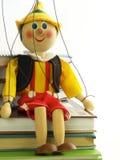 Die Marionette und das Lehrbuch Lizenzfreies Stockfoto