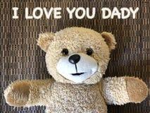 Die Mitteilung dieses ICH LIEBE DICH DADY durch netten Teddybären Stockfotografie