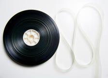 35 die mm-de spoel van de bioskoopfilm op wit wordt uitgerold Royalty-vrije Stock Afbeelding