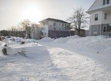 Die Nachwirkungen und die Reinigung des Blizzards von 2013 Lizenzfreies Stockfoto