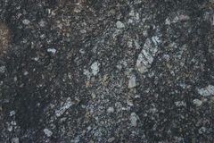 Die Nahaufnahme-Steinoberfläche der Natur im Freien am Abend stockbild