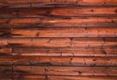 Die natürliche braune hölzerne Blockhauswand, die mit natürlichem Muster verwittert wird, wirbelt Hintergrund Stockfotografie