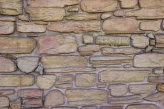 Die Natursteinwand stockfotografie