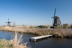 Die Niederlande, niederländische Windmühlen gestalten bei Kinderdijk nahe Rotterdam, eine UNESCO-Welterbestätte landschaftlich Lizenzfreie Stockbilder