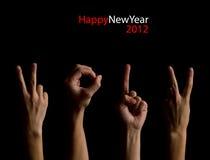 Die Nr. 2012 gezeigt durch Finger Stockbilder