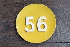 Die Nr. sechsundfünfzig auf der gelben Platte Lizenzfreie Stockfotografie