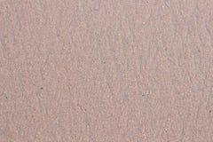 Die Oberfläche des Sandes, Spuren die Wasserführung Lizenzfreie Stockbilder