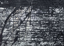 Die Oberfläche mit den Streifen des schwarzen Teers Stockfotografie