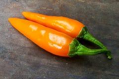 Die orange frischen Pfeffer Stockfotos