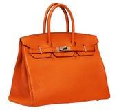 Die orange Lederhandtasche der Frauen Stockfotografie