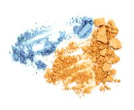 Die Orange und Blau, die zerquetscht werden, bildet Lidschattenpulver Stockfotos