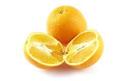 Die Orange und der Schnitt halb und halb. lizenzfreie stockbilder