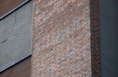 Die orange Ziegelsteine und die Wände II stockfotos