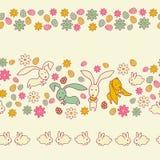 Die Ostereier, die Blumen und die Kaninchen Lizenzfreies Stockfoto
