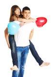Die Paare mit Ballons Lizenzfreies Stockbild