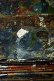 Die Palette und die Bürsten des Malers lizenzfreies stockbild