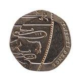 20 die pence muntstuk, het Verenigd Koninkrijk over wit wordt geïsoleerd Stock Foto