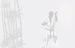 Die Person in einem Kimono nimmt an Karate teil Lizenzfreies Stockfoto