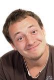 Die Person eines lächelnden jungen Mannes. Stockfotos