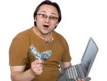 Die Person, Geld, ein Computer Stockbild