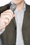Die Person mit einem Mikrofon Stockbild
