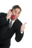 Die Person spricht durch das Telefon Stockbilder