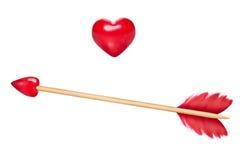 Die Pfeile des Amors mit Herzen stockfotos