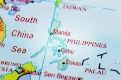 Die Philippinen auf Karte mit Scheinwerfereffekt Stockbild