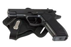 Die Pistolelagen auf Pistolenhalfter. lizenzfreie stockfotos