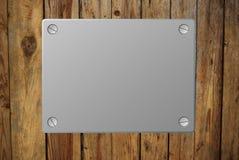 Die Platte auf dem alten Zaun lizenzfreies stockbild