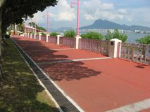 Die Promenade an Tai Po Waterfront-Park, Hong Kong stockfotos