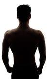 Die Rückseite des muskulösen Mannes im Schattenbild Lizenzfreie Stockbilder