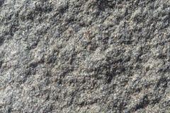 Die raue Oberfläche eines Granitstückes des Steins Stockfotos