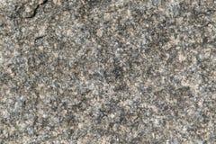 Die raue Oberfläche eines Granitstückes des Steins Lizenzfreie Stockfotografie
